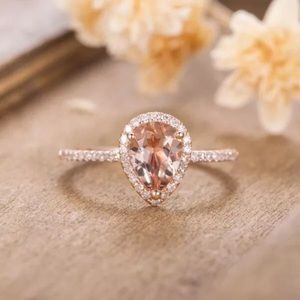 Rose gold plated pear shaped ring engagement